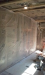 Insulation with Johns Manville formaldehye free paper faced batts, ceiled with plastic sheeting to create a impermeable vapor barrier on both sides of the wall section